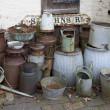 Old milk churns — Stock Photo