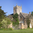 Stock Photo: Cotswold church and cottage