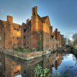 Moated historic house — Stock Photo