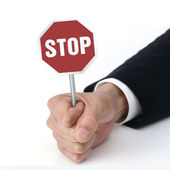 Holding stop sign board — Stock Photo