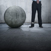 Leg chained to a big stone — Stock Photo