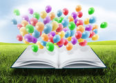 Open book with balloons — Stock Photo