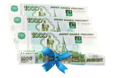 Ruble with gift bow isolated on white — Stock Photo