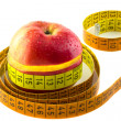 Photo: Apple with measuring tape isolated on white background