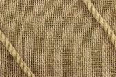 Rope on burlap background — Stock Photo