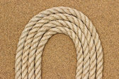 Jute rope on the sea sand. Background — Stock Photo