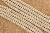 Jute rope on the sea sand — Stock Photo