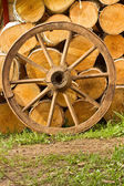 Old wagon wheel on a background of wood — Stock Photo