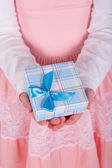 Little girl with a gift in his hand — Stock Photo