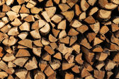 A stack of birch firewood - a natural horizontal background — Stock Photo
