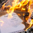 Burning Employee of the Month Certificate — Stock Photo
