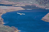 Yellow and White Airplane Flying Through the Canyon — ストック写真