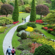 Relax walk through garden and park — Stock Photo
