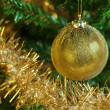Christmas decoration on the tree with gold chain — Stock Photo