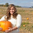 Girl holding a pumpkin — Stock Photo