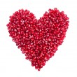 Garnet, grains, pomegranate seeds in the form of heart — Stock Photo #37746215