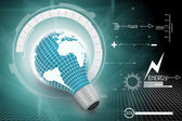 An electric light bulb with a world map — Stock Photo