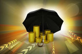 Gold coins under a black umbrella — Foto de Stock