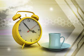 Alarm clock with cup of tea — Stock Photo