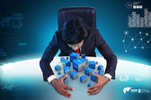 Business man with cubes — Stock Photo