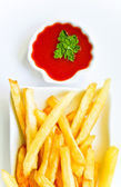 French fries with tomato sauce — Stock Photo