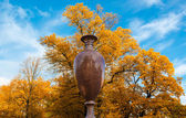 Granite vase in the park — Stock Photo
