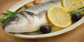 Sea Bass with vegetables and lemon  — Stock Photo
