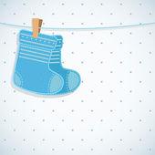 Baby boy shower card. Knitted socks on light background. — Stock Vector