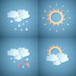 Set of four paper weather icons — Stock Vector