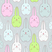 Seamless pattern with cute bunnies — Stock Vector