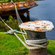 Rusty ship fixed in the harbour with ropes — Stock Photo