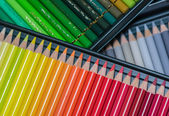 Numerous colored crayons assorted in a box — Stock Photo
