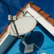 Foto Stock: Rooftop Satellite Antenna