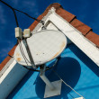 图库照片: Rooftop Satellite Antenna
