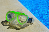 Diving goggles at the pool edge — Foto de Stock