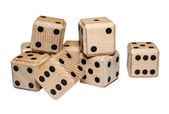 Isolated pile of numerous wooden dice — Stock Photo