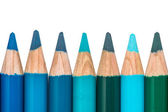 Row with Blue and Green Colored Crayons — Stock Photo