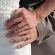 Wedding couple hands with rings on bride dress — Stock Photo