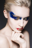 A blond woman with creative make up — Foto Stock