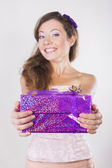 Beautiful happy girl receiving presents on her birthday party — Foto Stock