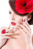 Brunette woman with poppy flower in her hair, poppy ring and creative nails on white background — Foto de Stock