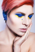 Young person closing ears and don't want to listen political lies crying. Ukrainian symbols and colors — Stock Photo