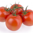 图库照片: Fresh of red juicy tomatoes isolated on white background