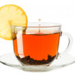 Glass cup of tea with lemon on a white background — Stock Photo #39017383
