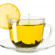 Glass cup of tea with lemon on a white background — Stock Photo #39017405