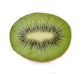 Slice of kiwi on a white — Stock Photo
