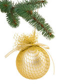 Christmas tree branch with a gold Christmas ball with ribbon — Stock Photo