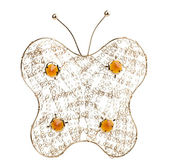 Gold filigree butterfly on a white background — Stock Photo