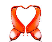 Red wine spilling and forming heart shape — Stock Photo