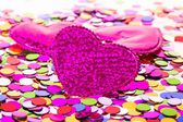 Three hearts on confetti background — 图库照片